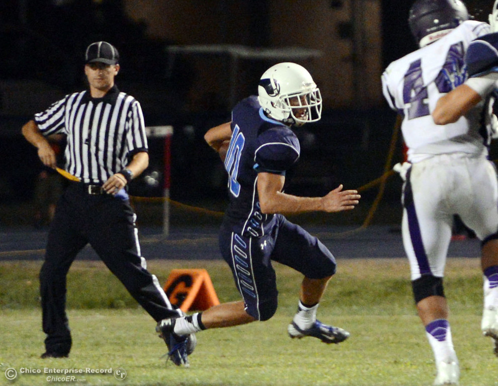 . Pleasant Valley High\'s #10 Tucker Larue (center) rushes against Oroville High in the second quarter of their football game at PVHS Asgard Yard Friday, September 20, 2013, in Chico, Calif. (Jason Halley/Chico Enterprise-Record)