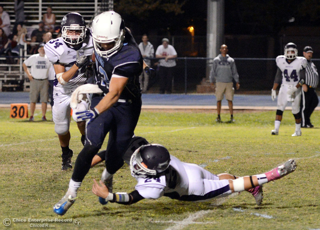 . Pleasant Valley High\'s #42 Chad Olsen (left) is tackled against Oroville High in the second quarter of their football game at PVHS Asgard Yard Friday, September 20, 2013, in Chico, Calif. (Jason Halley/Chico Enterprise-Record)
