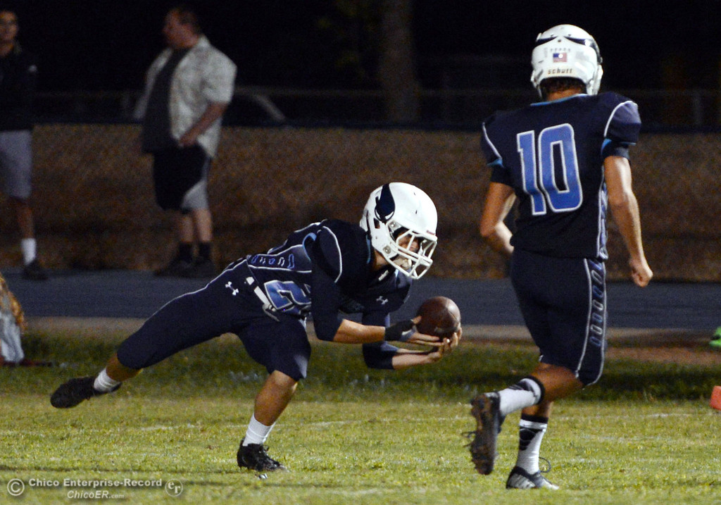 . Pleasant Valley High\'s #22 Jake Dani picks up a punt against Oroville High in the third quarter of their football game at PVHS Asgard Yard Friday, September 20, 2013, in Chico, Calif. (Jason Halley/Chico Enterprise-Record)