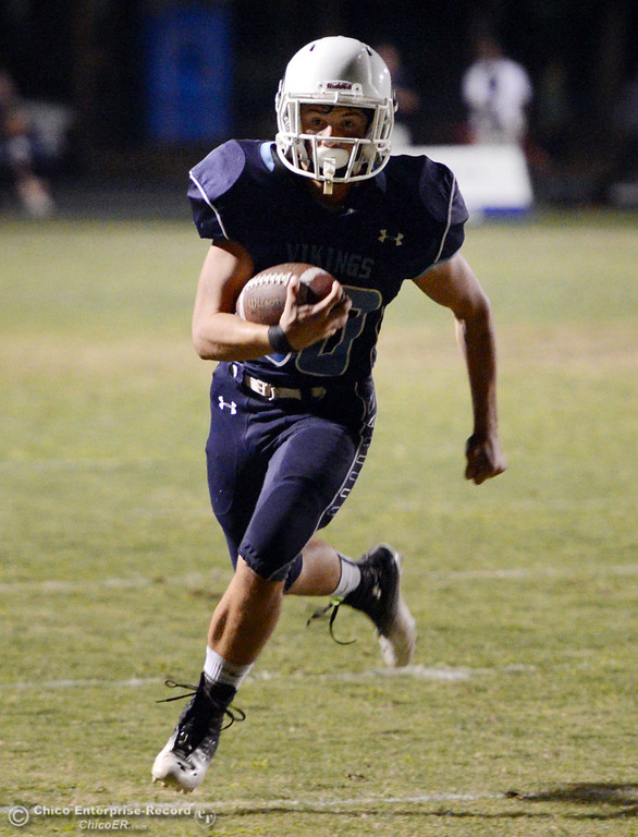 . Pleasant Valley High\'s #30 Connor Melton rushes for a touchdown against Oroville High in the second quarter of their football game at PVHS Asgard Yard Friday, September 20, 2013, in Chico, Calif. (Jason Halley/Chico Enterprise-Record)