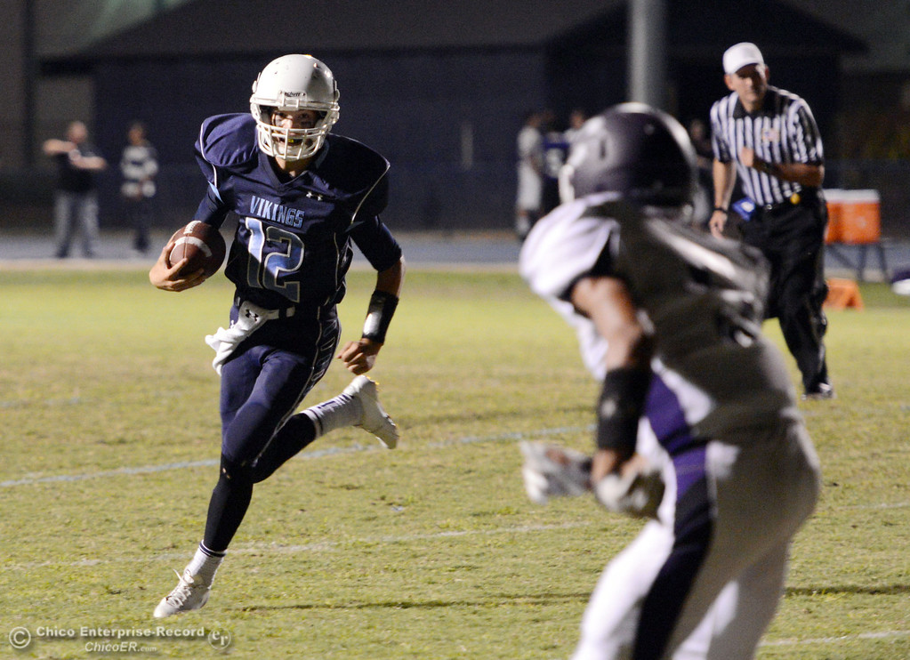. Pleasant Valley High\'s #12 Trent Darms (left) rushes against Oroville High in the second quarter of their football game at PVHS Asgard Yard Friday, September 20, 2013, in Chico, Calif. (Jason Halley/Chico Enterprise-Record)