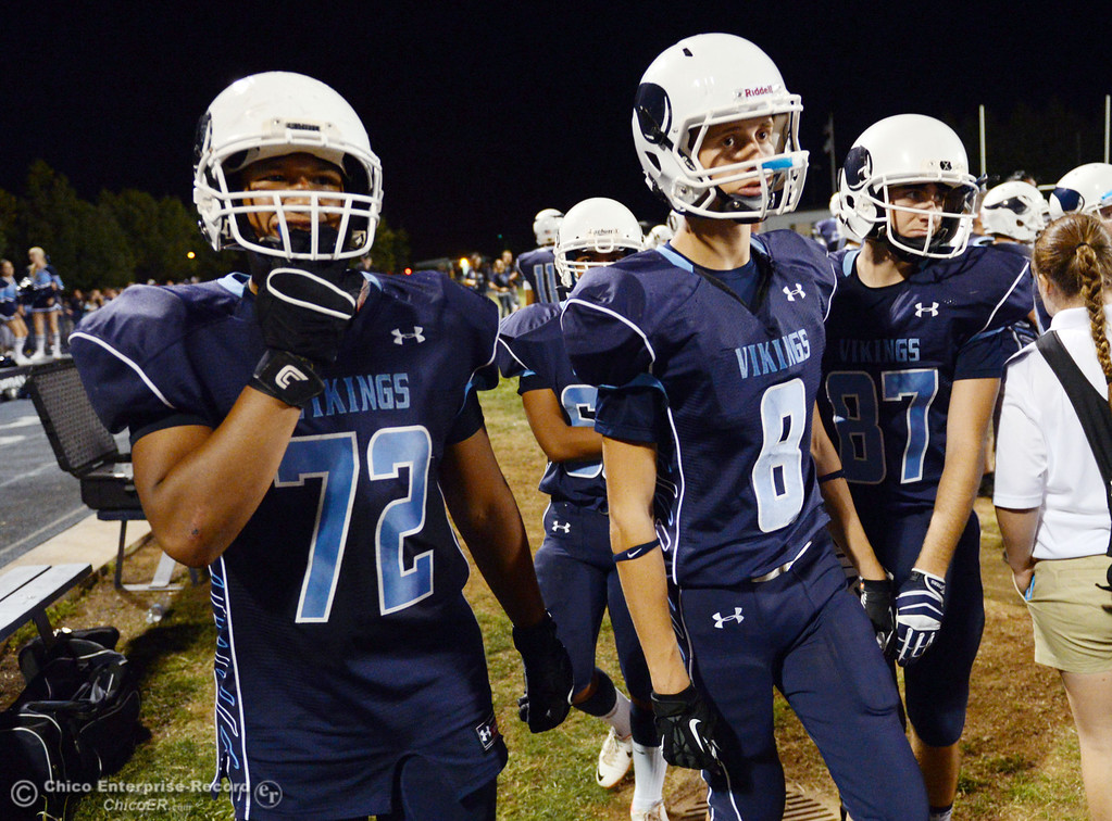 . Pleasant Valley High\'s #72 Christian Darden (left) and #8 Brandon Bierman (right) against Oroville High in the second quarter of their football game at PVHS Asgard Yard Friday, September 20, 2013, in Chico, Calif. (Jason Halley/Chico Enterprise-Record)