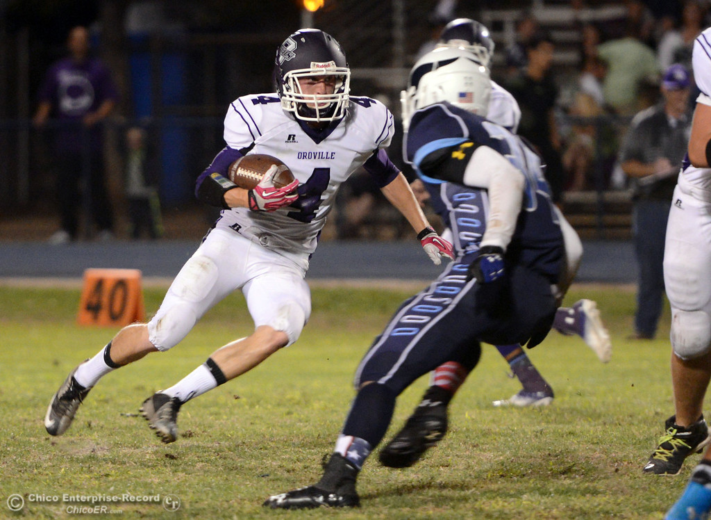 . Pleasant Valley High\'s #34 Cale Crawford (right) defends against Oroville High\'s #4 Antony Ramsey (left) who rushes in the first quarter of their football game at PVHS Asgard Yard Friday, September 20, 2013, in Chico, Calif. (Jason Halley/Chico Enterprise-Record)