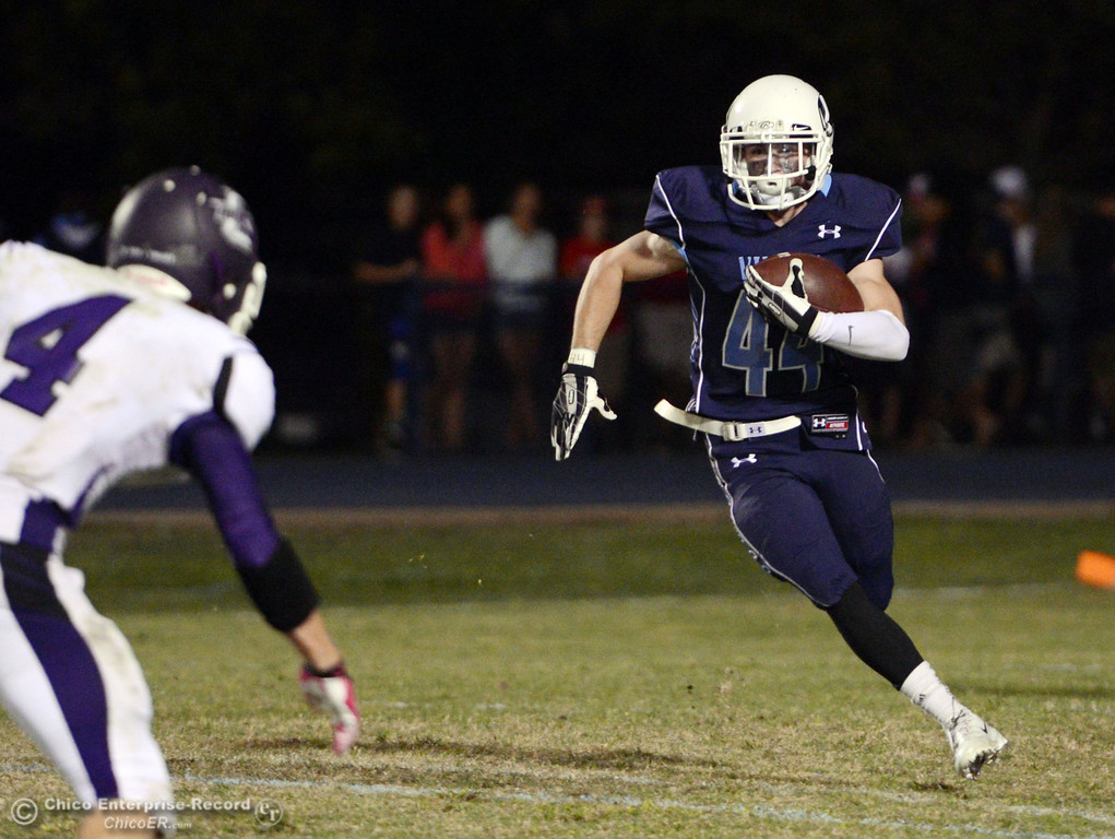 . Pleasant Valley High\'s #44 Cyland Leitner rushes against Oroville High in the fourth quarter of their football game at PVHS Asgard Yard Friday, September 20, 2013, in Chico, Calif. (Jason Halley/Chico Enterprise-Record)