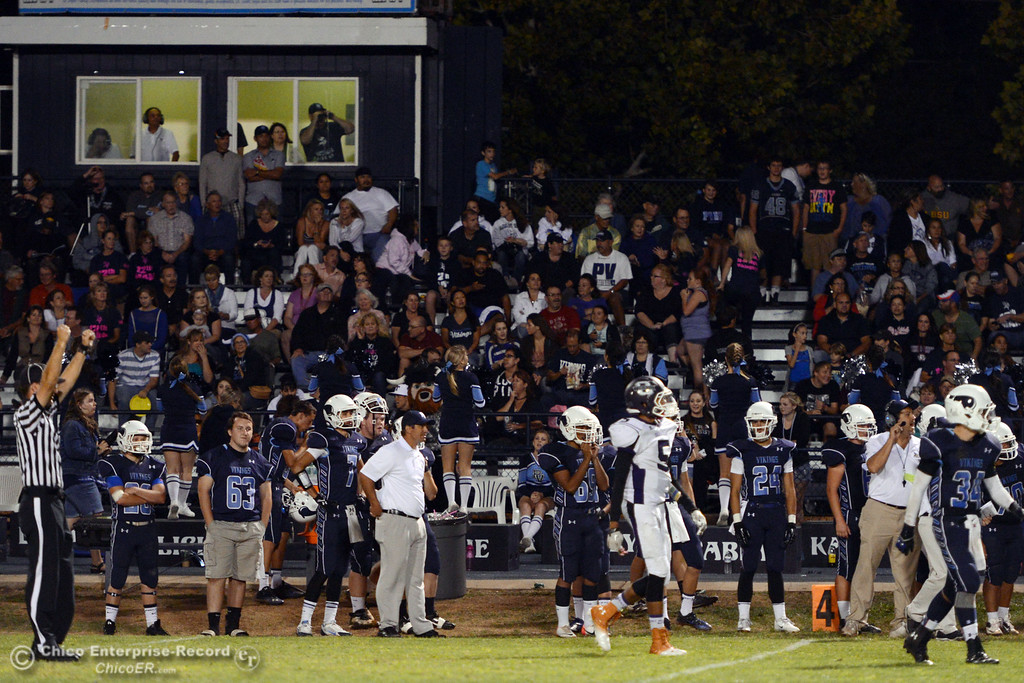 . Pleasant Valley High sidelines look on against Oroville High in the third quarter of their football game at PVHS Asgard Yard Friday, September 20, 2013, in Chico, Calif. (Jason Halley/Chico Enterprise-Record)