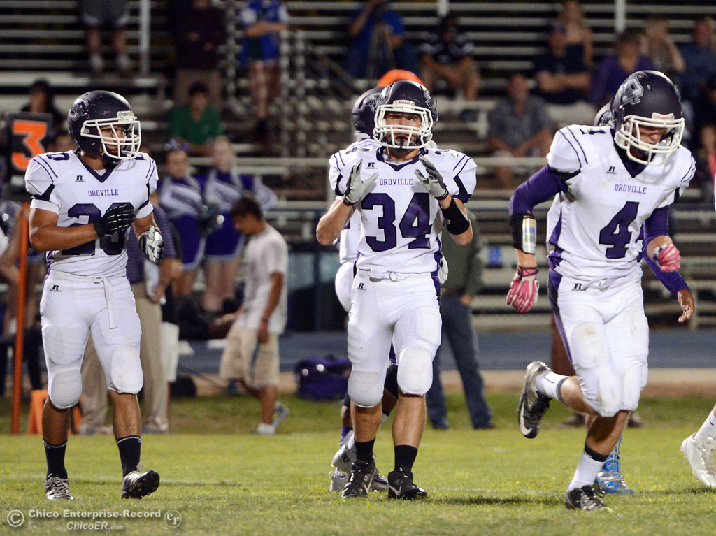 . Pleasant Valley High against Oroville High\'s #20 Brandon Tewksbury (left) #34 Thomas Miller (center) and 34 Antony Ramsey (right) in the first quarter of their football game at PVHS Asgard Yard Friday, September 20, 2013, in Chico, Calif. (Jason Halley/Chico Enterprise-Record)