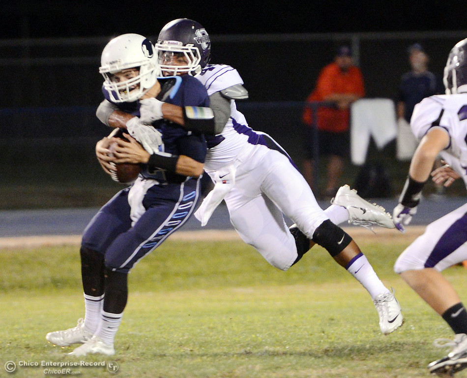 . Pleasant Valley High\'s #12 Trent Darms (left) is sacked against Oroville High\'s #44 Derrek Gordon (right) in the first quarter of their football game at PVHS Asgard Yard Friday, September 20, 2013, in Chico, Calif. (Jason Halley/Chico Enterprise-Record)