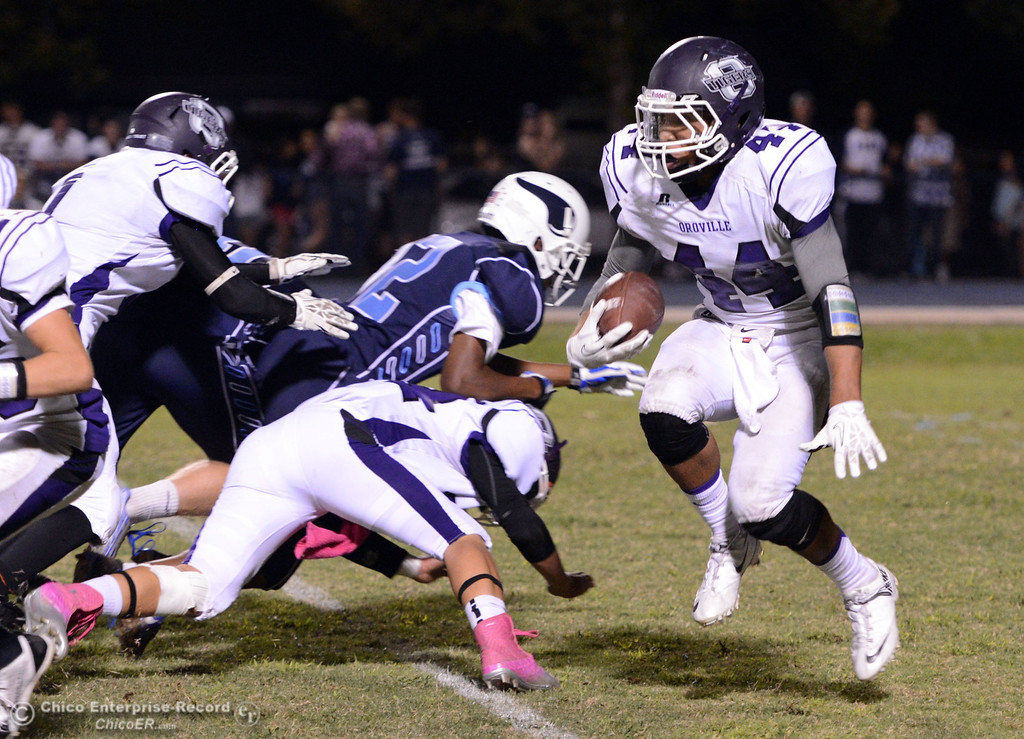 . Pleasant Valley High against Oroville High\'s #44 Derek Gordon (right) rushes in the third quarter of their football game at PVHS Asgard Yard Friday, September 20, 2013, in Chico, Calif. (Jason Halley/Chico Enterprise-Record)