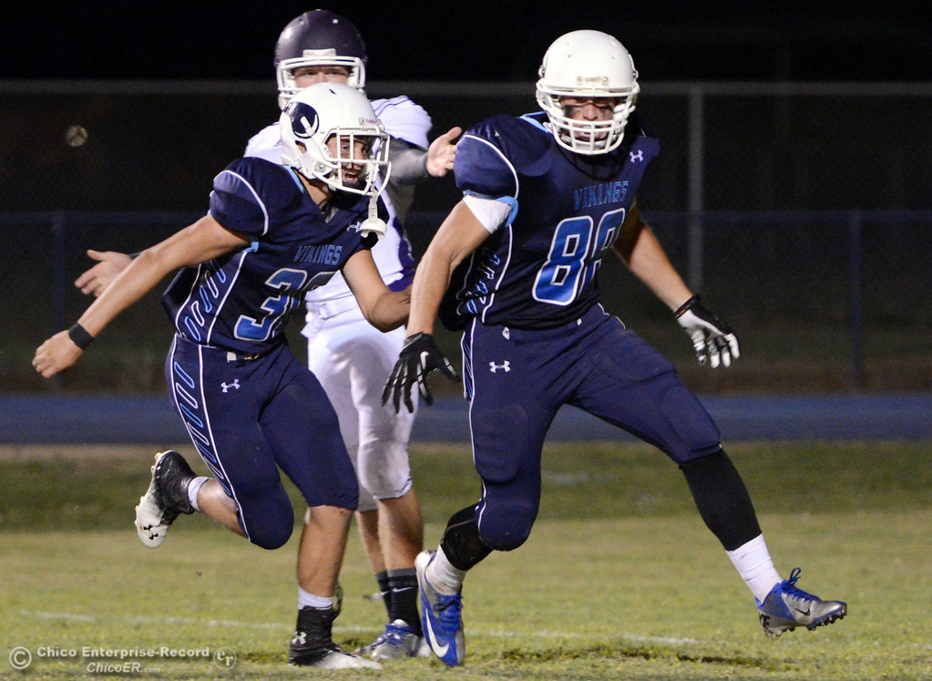 . Pleasant Valley High\'s #30 Connor Melton (left) reacts with #88 Zack Suttles (right) who blocked a punt against Oroville High in the second quarter of their football game at PVHS Asgard Yard Friday, September 20, 2013, in Chico, Calif. (Jason Halley/Chico Enterprise-Record)
