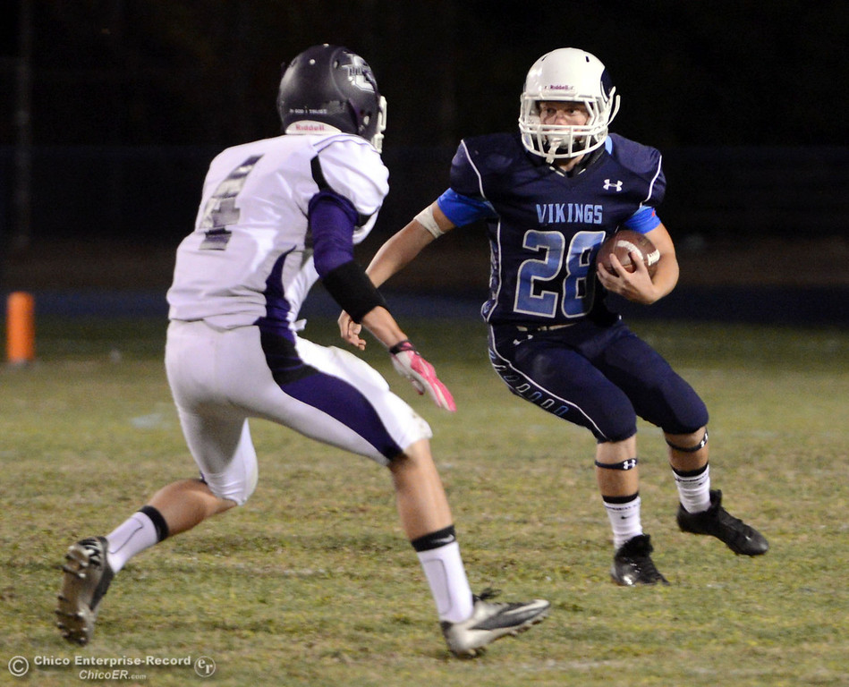 . Pleasant Valley High\'s #28 Dylan Batie (right) rushes against Oroville High\'s #4 Antony Ramsey (left) in the first quarter of their football game at PVHS Asgard Yard Friday, September 20, 2013, in Chico, Calif. (Jason Halley/Chico Enterprise-Record)
