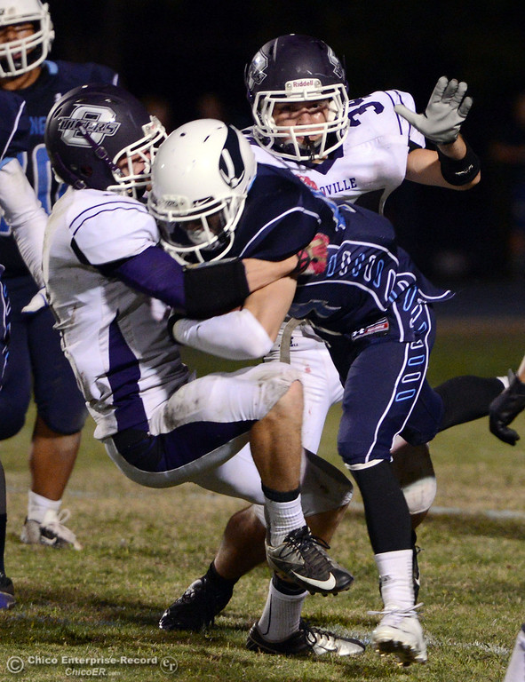 . Pleasant Valley High\'s #44 Cyland Leitner (center) is tackled against Oroville High\'s #4 Antony Ramsey (left) and #34 Thomas Miller (right) in the fourth quarter of their football game at PVHS Asgard Yard Friday, September 20, 2013, in Chico, Calif. (Jason Halley/Chico Enterprise-Record)