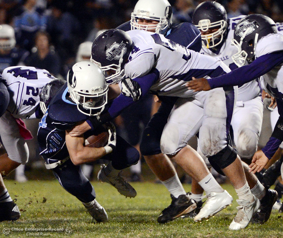 . Pleasant Valley Highs\' #44 Cylan Leitner (left) is tackled against Oroville High\'s #54 Kory Stenberg (right) in the third quarter of their football game at PVHS Asgard Yard Friday, September 20, 2013, in Chico, Calif. (Jason Halley/Chico Enterprise-Record)