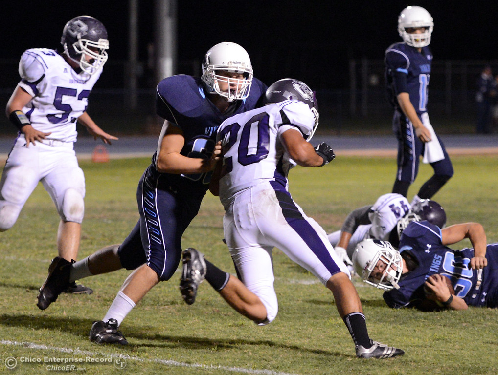 . Pleasant Valley High\'s #68 Jacob Gregg (left) lays a block against Oroville High\'s #20 Brandon Tewksbury (right) in the first quarter of their football game at PVHS Asgard Yard Friday, September 20, 2013, in Chico, Calif. (Jason Halley/Chico Enterprise-Record)