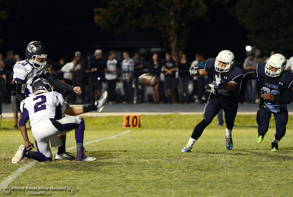 . Pleasant Valley High against Oroville High\'s #40 Taner Dubie (left) kicks the extra point (left) in the fourth quarter of their football game at PVHS Asgard Yard Friday, September 20, 2013, in Chico, Calif. (Jason Halley/Chico Enterprise-Record)