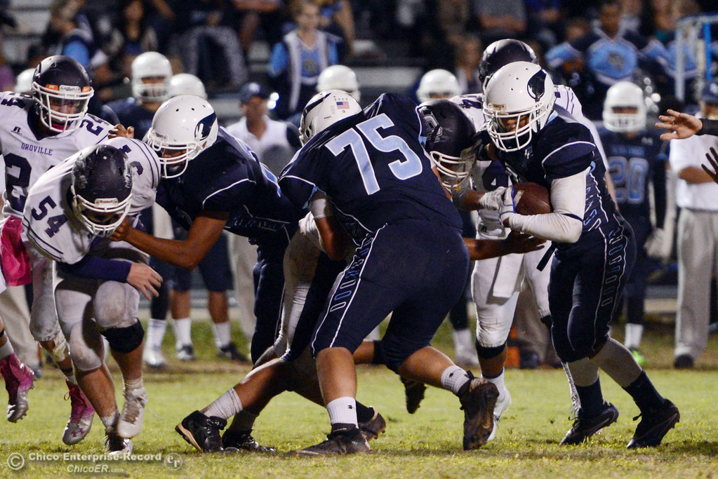 . Pleasant Valley High\'s #56 (right)  against Oroville High in the fourth quarter of their football game at PVHS Asgard Yard Friday, September 20, 2013, in Chico, Calif. (Jason Halley/Chico Enterprise-Record)