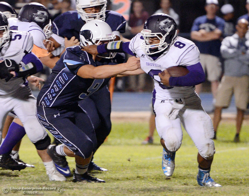 . Pleasant Valley High\'s #9 Houston McGowan (left) tackles against Oroville High\'s #8 James Jones (right) in the second quarter of their football game at PVHS Asgard Yard Friday, September 20, 2013, in Chico, Calif. (Jason Halley/Chico Enterprise-Record)