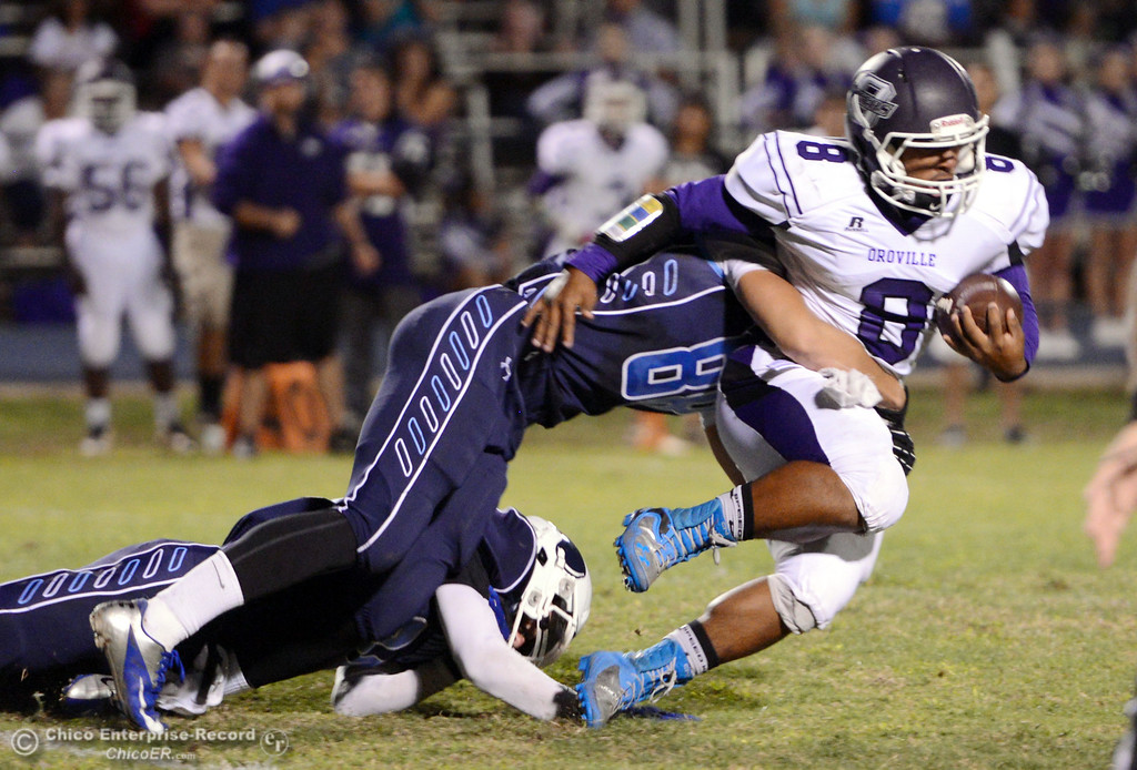 . Pleasant Valley High\'s #88 Zack Suttles (left) tackles against Oroville High\'s #8 James Jones (right) in the first quarter of their football game at PVHS Asgard Yard Friday, September 20, 2013, in Chico, Calif. (Jason Halley/Chico Enterprise-Record)