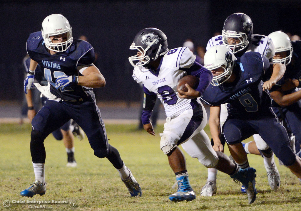 . Pleasant Valley High\'s #42 Chad Olsen (left) and #9 Houston McGowan (right) defend against Oroville High\'s #8 James Jones (center) in the second quarter of their football game at PVHS Asgard Yard Friday, September 20, 2013, in Chico, Calif. (Jason Halley/Chico Enterprise-Record)