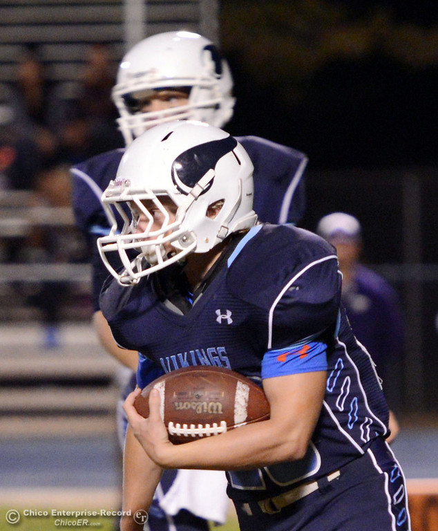 . Pleasant Valley High\'s #28 Dylan Batie rushes against Oroville High in the first quarter of their football game at PVHS Asgard Yard Friday, September 20, 2013, in Chico, Calif. (Jason Halley/Chico Enterprise-Record)