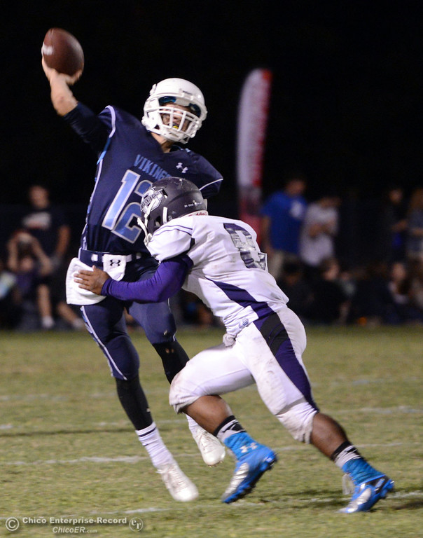 . Pleasant Valley High\'s #12 Trent Darms (left) is pressured against Oroville High\'s #8 James Jones (right) in the third quarter of their football game at PVHS Asgard Yard Friday, September 20, 2013, in Chico, Calif. (Jason Halley/Chico Enterprise-Record)
