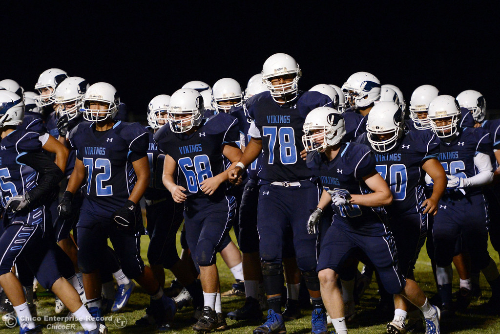 . Pleasant Valley High team takes the field against Oroville High in the third quarter of their football game at PVHS Asgard Yard Friday, September 20, 2013, in Chico, Calif. (Jason Halley/Chico Enterprise-Record)