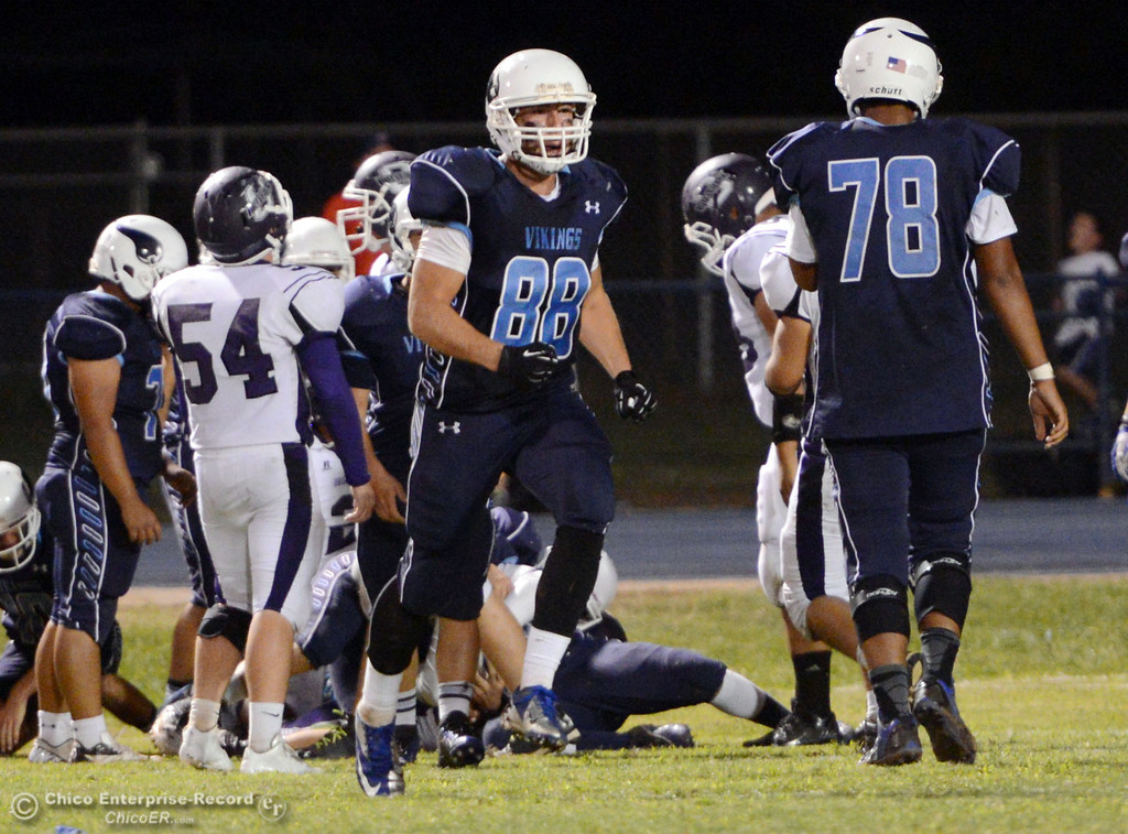 . Pleasant Valley High\'s #88 Zack Suttles (center) against Oroville High in the second quarter of their football game at PVHS Asgard Yard Friday, September 20, 2013, in Chico, Calif. (Jason Halley/Chico Enterprise-Record)