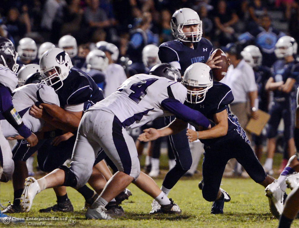. Pleasant Valley High\'s #17 Troy Owens (top) drops back to pass against Oroville High in the fourth quarter of their football game at PVHS Asgard Yard Friday, September 20, 2013, in Chico, Calif. (Jason Halley/Chico Enterprise-Record)