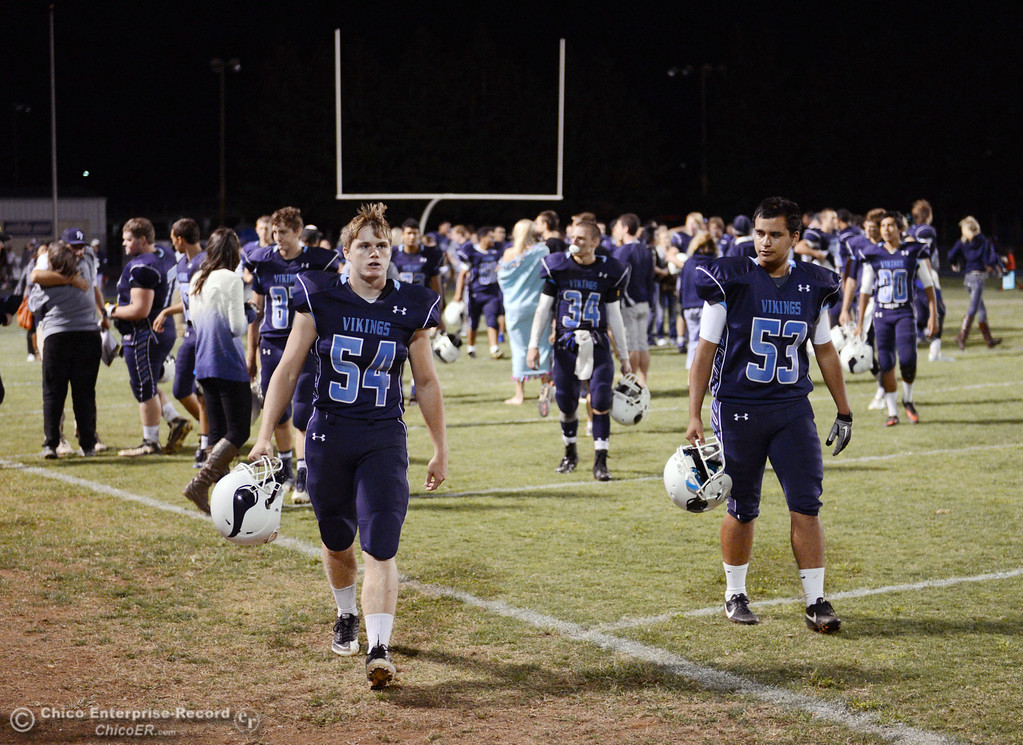 . Pleasant Valley High #54 Zack Gillam (left) and Christian Miranda (right) celebrates their win against Oroville High in their football game at PVHS Asgard Yard Friday, September 20, 2013, in Chico, Calif. (Jason Halley/Chico Enterprise-Record)