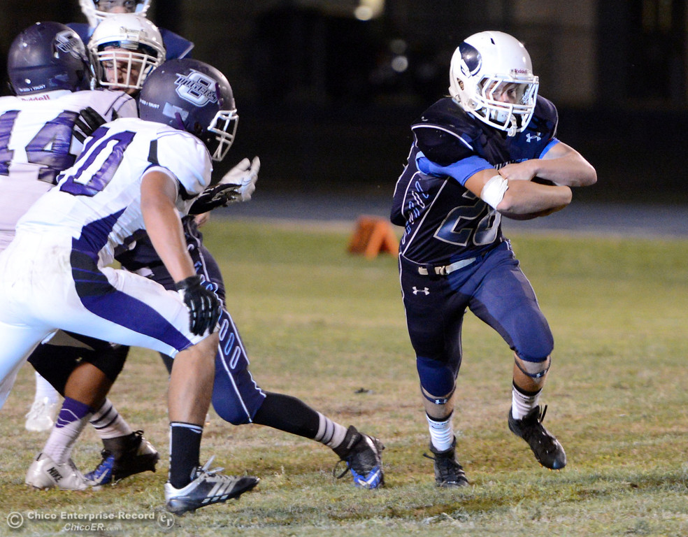 . Pleasant Valley High\'s #28 Dylan Batie (right) rushes against Oroville High in the second quarter of their football game at PVHS Asgard Yard Friday, September 20, 2013, in Chico, Calif. (Jason Halley/Chico Enterprise-Record)