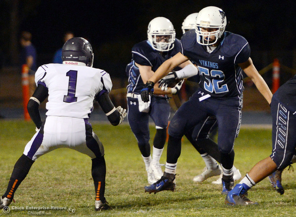. Pleasant Valley High\'s #52 Riley Andrew (right) blocks against Oroville High\'s #1 Michael Ripley (left) in the third quarter of their football game at PVHS Asgard Yard Friday, September 20, 2013, in Chico, Calif. (Jason Halley/Chico Enterprise-Record)