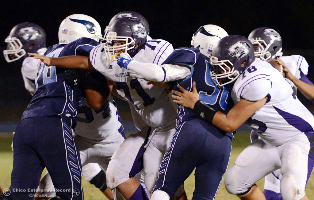 . Pleasant Valley High against Oroville High\'s #71 Angel Leal (left) and #78 Alec Mitchell (right) in the second quarter of their football game at PVHS Asgard Yard Friday, September 20, 2013, in Chico, Calif. (Jason Halley/Chico Enterprise-Record)
