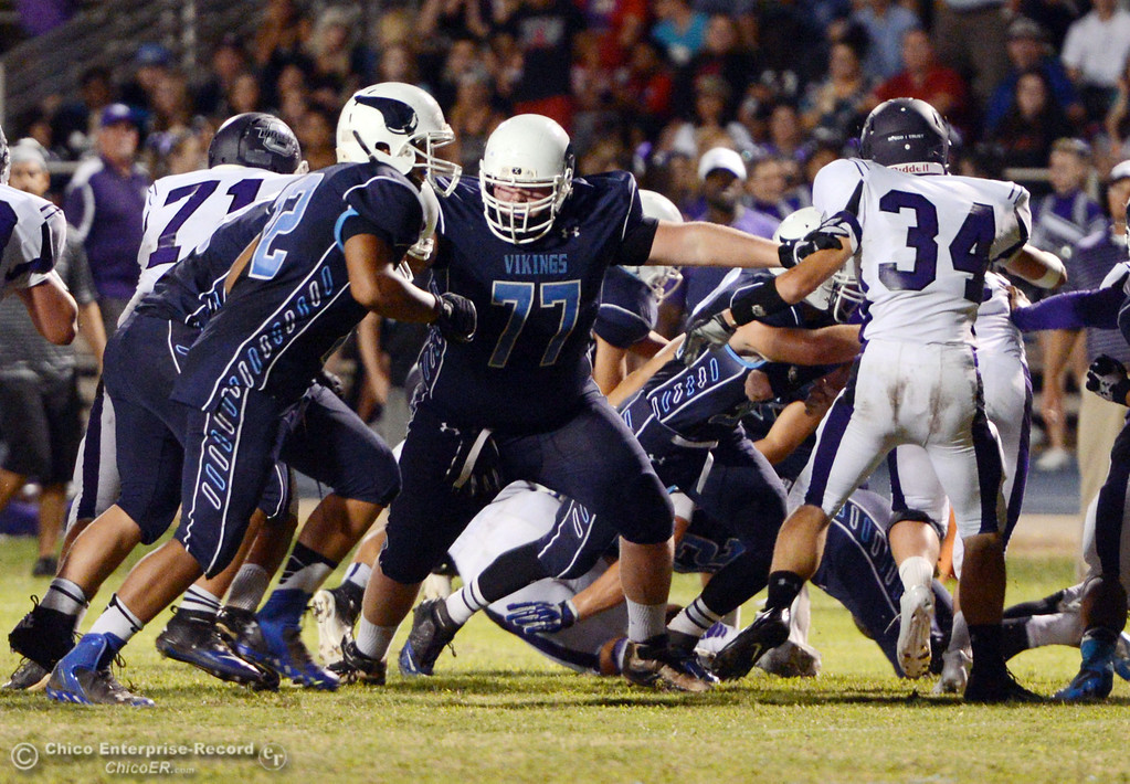 . Pleasant Valley High\'s #77 Tyler Stimac (center) blocks against Oroville High in the second quarter of their football game at PVHS Asgard Yard Friday, September 20, 2013, in Chico, Calif. (Jason Halley/Chico Enterprise-Record)
