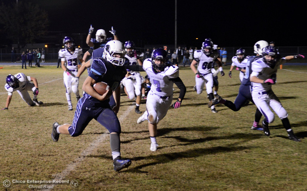 . Pleasant Valley High\'s #9 Houston McGowan (left) rushes in for a touchdown against Shasta High in the first quarter of their football game at PVHS Asgard Yard Friday, October 18, 2013 in Chico, Calif.  (Jason Halley/Chico Enterprise-Record)