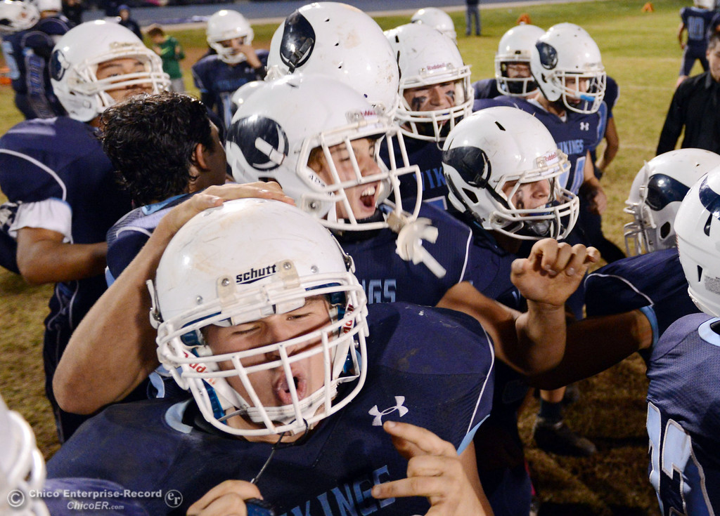. Pleasant Valley High celebrates their win against Shasta High in the fourth quarter of their football game at PVHS Asgard Yard Friday, October 18, 2013 in Chico, Calif.  (Jason Halley/Chico Enterprise-Record)