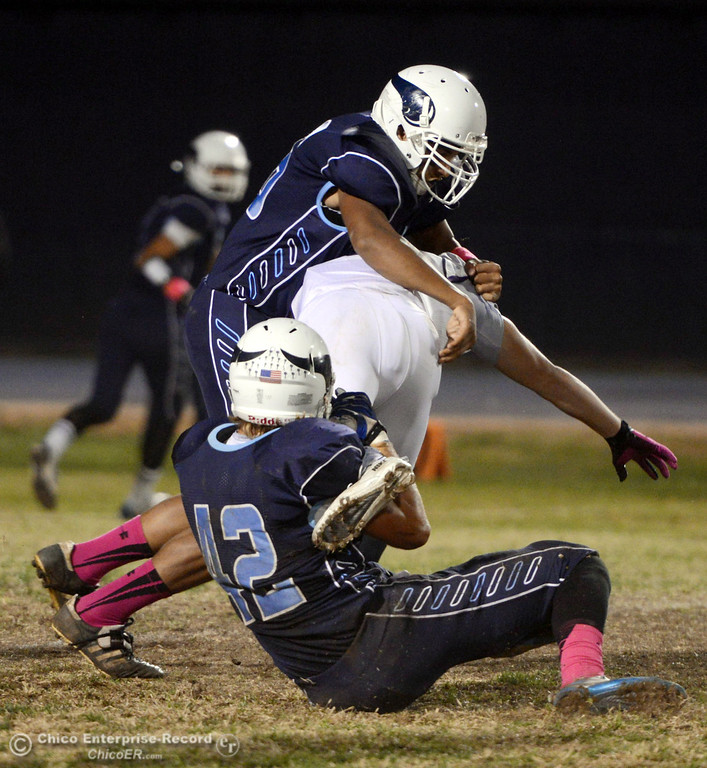 . Shasta High\'s #5 Jake Callaway (center) is tackled by Pleasant Valley High\'s #42 Chad Olsen (bottom) with #76 Bailey Wasden (top) in the first quarter of their football game at PVHS Asgard Yard Friday, October 18, 2013 in Chico, Calif.  (Jason Halley/Chico Enterprise-Record)