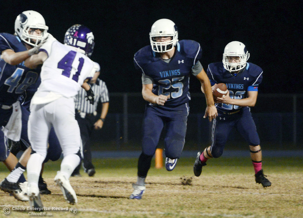 . Pleasant Valley High\'s #25 Ryan Steindorf (left) blocks for #28 Dylan Batie (right) against Shasta High in the second quarter of their football game at PVHS Asgard Yard Friday, October 18, 2013 in Chico, Calif.  (Jason Halley/Chico Enterprise-Record)
