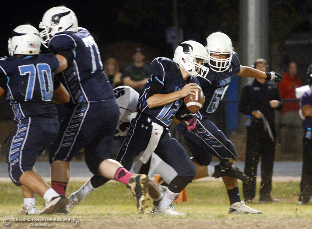 . Pleasant Valley High\'s #12 Trent Darms (center) rushes against Shasta High in the first quarter of their football game at PVHS Asgard Yard Friday, October 18, 2013 in Chico, Calif.  (Jason Halley/Chico Enterprise-Record)