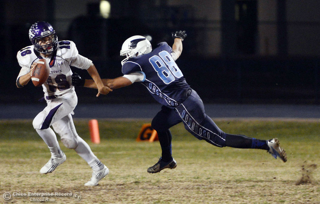. Pleasant Valley High\'s #88 Zack Suttles (right) pressures against Shasta High\'s #18 Bailey Odell (left) in the second quarter of their football game at PVHS Asgard Yard Friday, October 18, 2013 in Chico, Calif.  (Jason Halley/Chico Enterprise-Record)