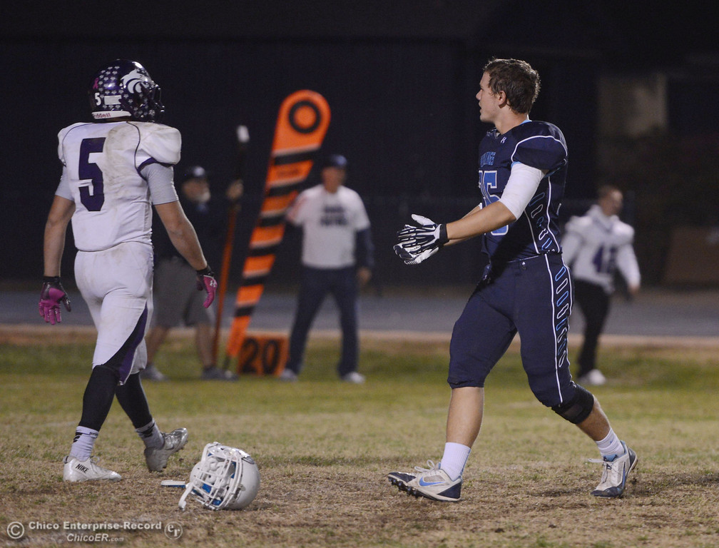 . Pleasant Valley High\'s #35 Benjamin Whitmore talks to ref about a play where he lost his helmet against Shasta High in the second quarter of their football game at PVHS Asgard Yard Friday, October 18, 2013 in Chico, Calif.  (Jason Halley/Chico Enterprise-Record)