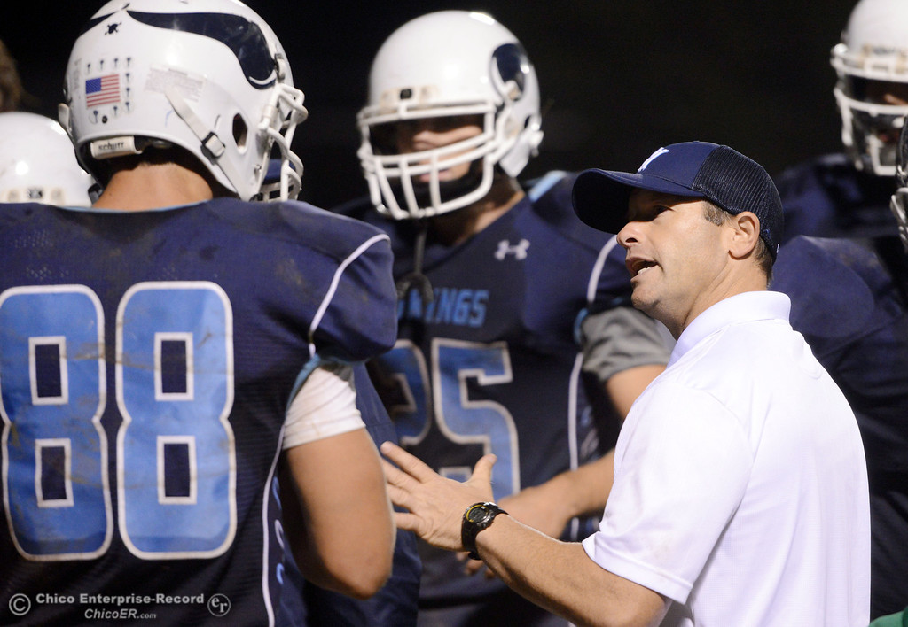 . Pleasant Valley High coach Mark Cooley (right) talks to #88 Zack Suttles (left) against Shasta High in the fourth quarter of their football game at PVHS Asgard Yard Friday, October 18, 2013 in Chico, Calif.  (Jason Halley/Chico Enterprise-Record)