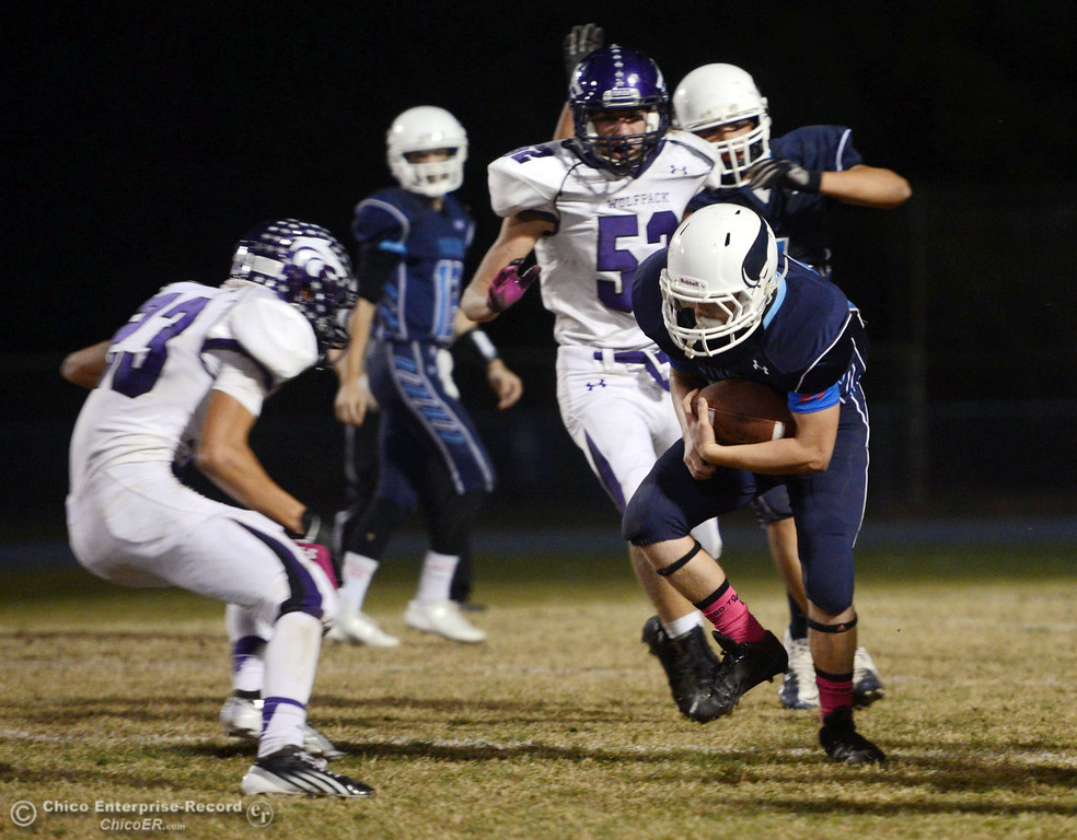 . Pleasant Valley High\'s #28 Dylan Batie (right) rushes against Shasta High\'s #23 Ryan Pallato (left) in the second quarter of their football game at PVHS Asgard Yard Friday, October 18, 2013 in Chico, Calif.  (Jason Halley/Chico Enterprise-Record)