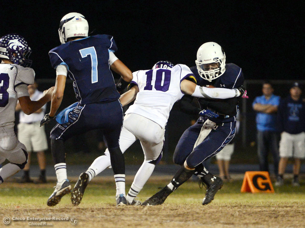 . Pleasant Valley Highs\' #34 Cale Crawford (right) is tackled against Shasta High\'s #10 Noah Ferguson (left) in the second quarter of their football game at PVHS Asgard Yard Friday, October 18, 2013 in Chico, Calif.  (Jason Halley/Chico Enterprise-Record)