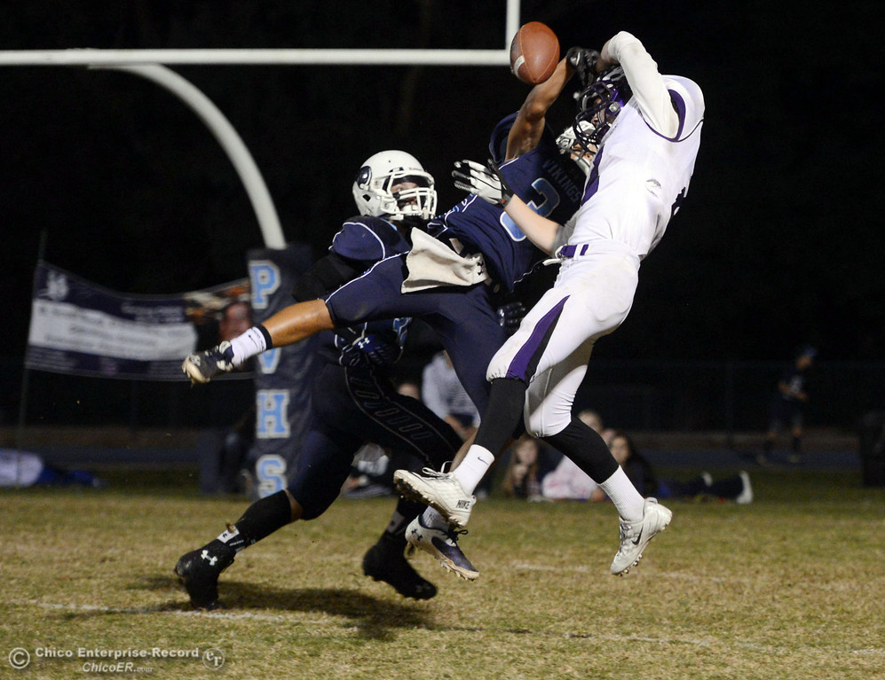 . Pleasant Valley High\'s #34 Cale Crawford (left) and #3 Brandon Romero (center) break up a pass intended for  Shasta High\'s #2 Josh Rubideaux (right) in the second quarter of their football game at PVHS Asgard Yard Friday, October 18, 2013 in Chico, Calif.  (Jason Halley/Chico Enterprise-Record)
