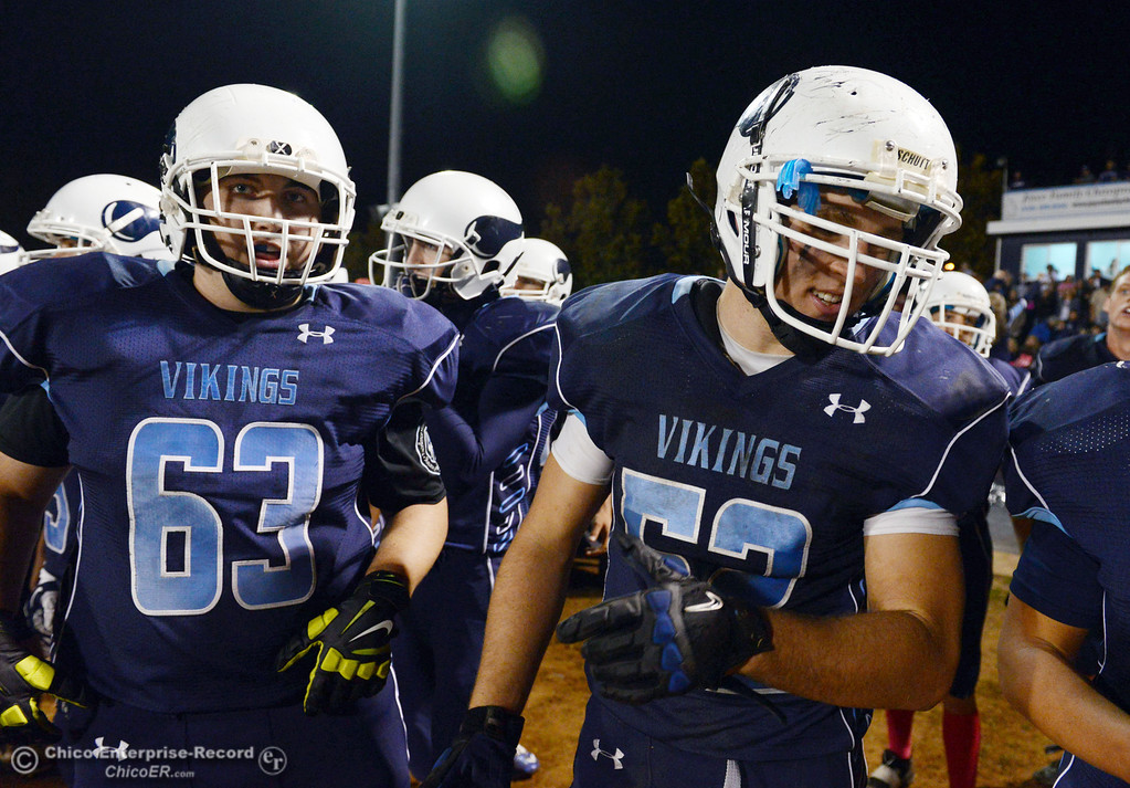 . Pleasant Valley Highs\' #63 Harrison Carter (left) and #52 Riley Andrew (right) against Shasta High in the fourth quarter of their football game at PVHS Asgard Yard Friday, October 18, 2013 in Chico, Calif.  (Jason Halley/Chico Enterprise-Record)
