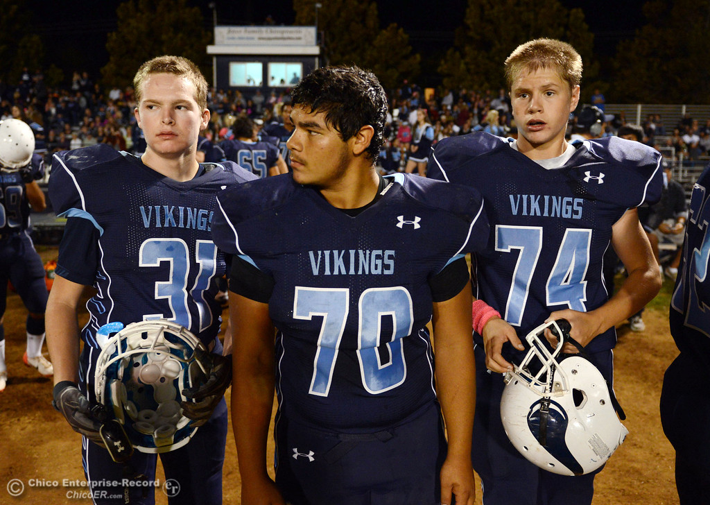 . Pleasant Valley High\'s #31 Cody Tavenner, #70 Josh Alvarez and #74 Izaak Farley (left to right) against Shasta High in the first quarter of their football game at PVHS Asgard Yard Friday, October 18, 2013 in Chico, Calif.  (Jason Halley/Chico Enterprise-Record)