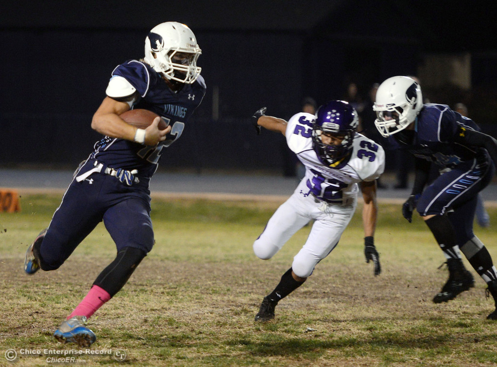 . Pleasant Valley High\'s #42 Chad Olsen (left) rushes against Shasta High\'s #32 Trevon Lewis (right) with PV\'s #34 Cale Crawford (right) in the first quarter of their football game at PVHS Asgard Yard Friday, October 18, 2013 in Chico, Calif.  (Jason Halley/Chico Enterprise-Record)