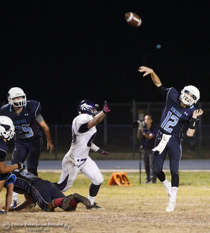 . Pleasant Valley High\'s #12 Trent Darms throws a deep pass against Shasta High in the second quarter of their football game at PVHS Asgard Yard Friday, October 18, 2013 in Chico, Calif.  (Jason Halley/Chico Enterprise-Record)