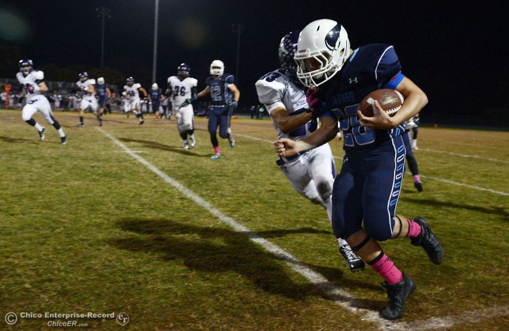. Pleasant Valley High\'s #28 Dylan Batie (front) is pushed out of bounds against Shasta High\'s #23 Ryan Pallato (back) in the second quarter of their football game at PVHS Asgard Yard Friday, October 18, 2013 in Chico, Calif.  (Jason Halley/Chico Enterprise-Record)