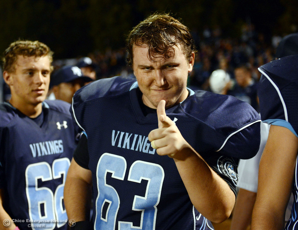 . Pleasant Valley High\'s #63 Harrison Carter gestures against Shasta High in the first quarter of their football game at PVHS Asgard Yard Friday, October 18, 2013 in Chico, Calif.  (Jason Halley/Chico Enterprise-Record)