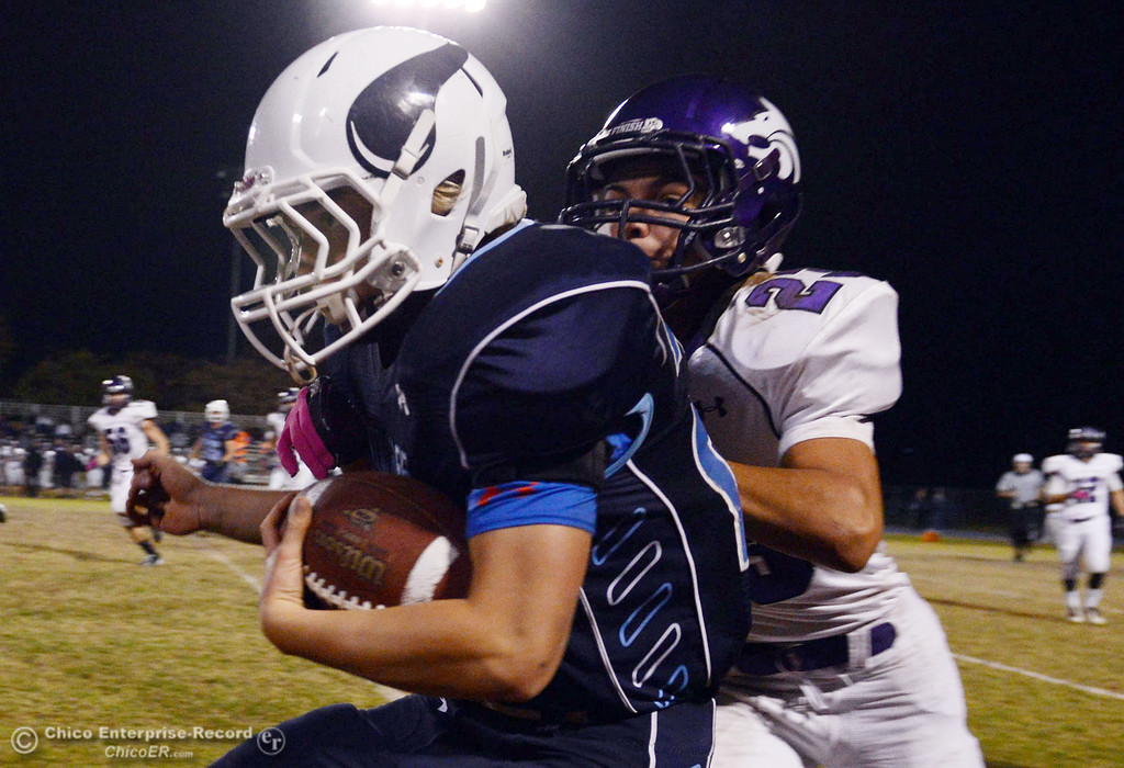 . Pleasant Valley High\'s #28 Dylan Batie (left) is pushed out of bounds against Shasta High\'s #23 Ryan Pallato (right) in the second quarter of their football game at PVHS Asgard Yard Friday, October 18, 2013 in Chico, Calif.  (Jason Halley/Chico Enterprise-Record)